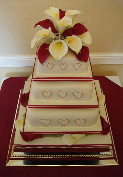 small wedding cakes with ribbon and toppers food and drink