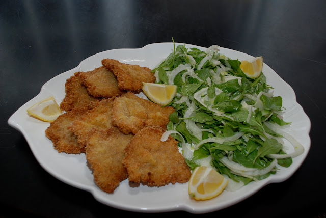 ... Keller-Veal Cutlets Served Family Style with Arugula and Fennel Salad