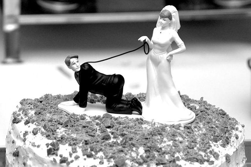 black and white funny wedding cake with bride and groom