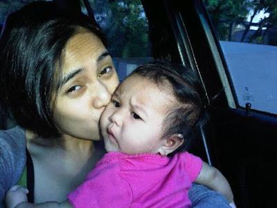 Masayu Anastasia kisses her baby girl