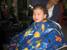 getting his hair cut