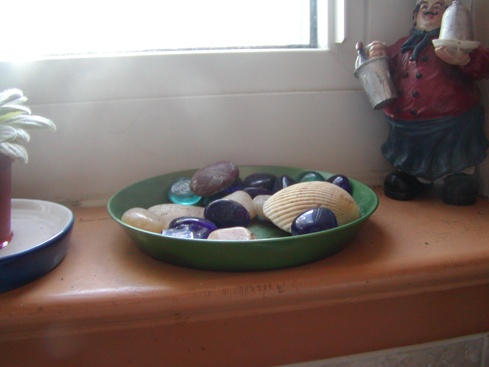 Use something like this tray filled with gems and shells (above  #643A2C