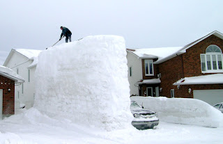 Luc Guertin of Ottawa, Ontario, Canada built a 17 foot tall, six feet wide, and 30 feet long snow wall in his driveway, winter 2007-8
