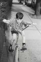 dorky dangerous bicycle kid dork idiot riding on sidewalk