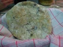 Home-made pita bread with olives Greta style