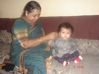 enjoying the ear cleaning time with dadi grandmother