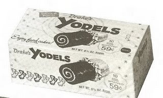 Yodels: Chocolate frosted creme filled Swiss roll. Sold as one two ...