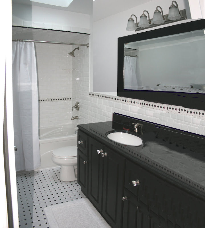 Bathroom with Black & White decor & Subway tiles title=
