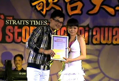 Tan Kai Qing 陈凯晴 - Getai Awards 歌台大奖 was awarded 2009 STOMP Getai Best Newcomer Award - 2009 STOMP 歌台大奖 最佳新人奖 to honour their effort throughout the year on Getai 歌台 stage and are awarded by STOMP Getai Award - STOMP 歌台大奖.