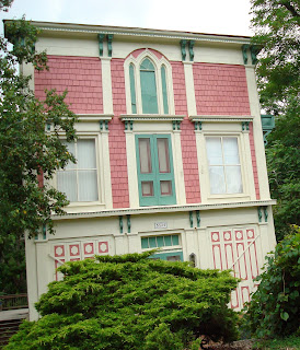 A pink house in Snowville with a faux facade