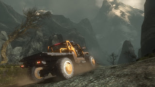 photo of a truck driving across a mountainous landscape in halo reach