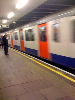 Tube+train+departing+from+station