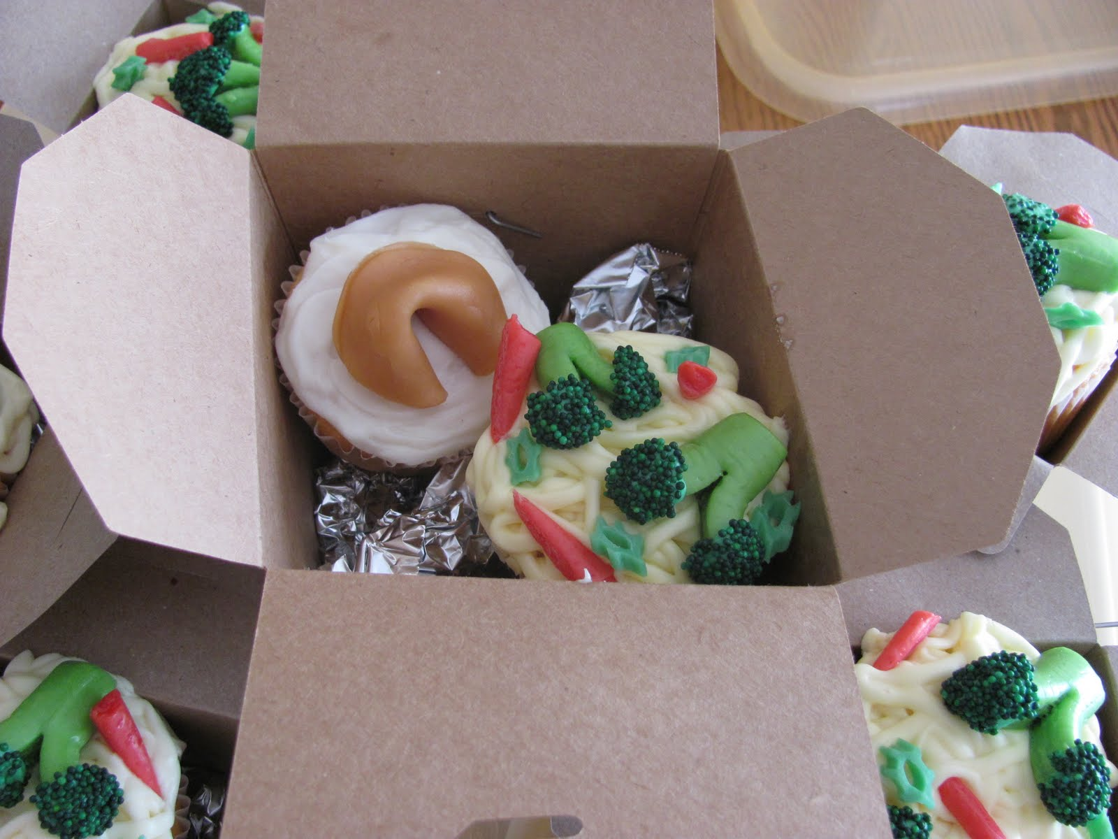 placed the cupcakes in brown Take-Out boxes, for a little ...