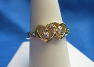 Custom made anniversary ring in 14 karat yellow gold by jewelry designer Tony Payne