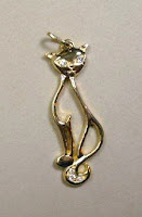 Custom made gold cat pendant with diamonds