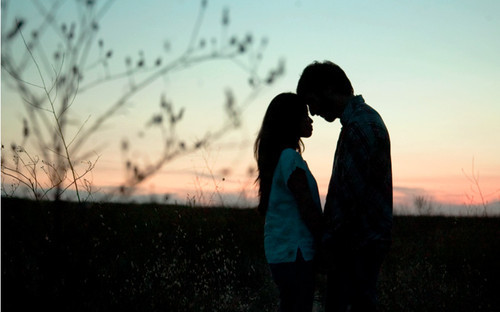 couple kissing silhouette image. couple kissing silhouette