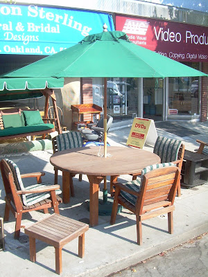 Redwood Table, Four Chairs, Rocker And Small Table. Includes Large  Weather Resistant Umbrella. Excellent Value.