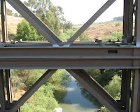 A view of the Jordan River through the bridge