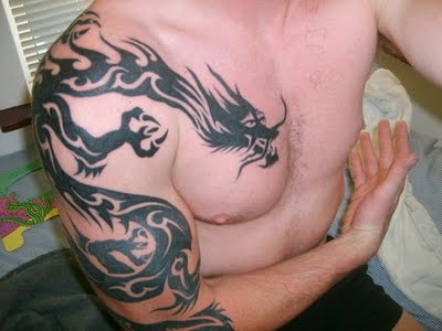 star tattoos for men on chest. Men with Tribal Dragon Tatoo