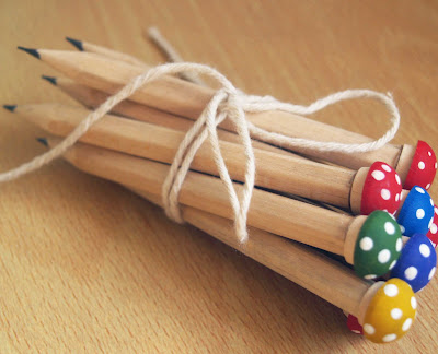 OhILikeThat recently posted up these super cute DIY mushroom pencils - also a great favor idea, or could work as the guest book pens.