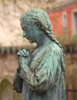 say your prayers - statue on cemetery pere lachaise, paris