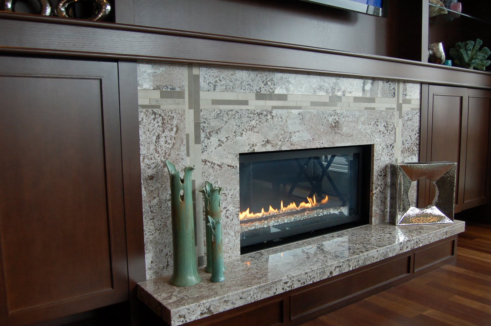 The granite gurus 5 fireplaces that make me melt for Fireplace and hearth designs