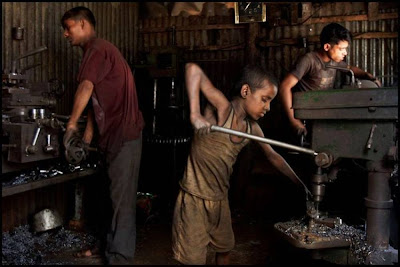 Childern Working On Drill Machine