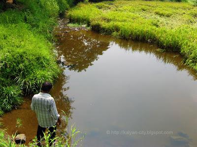 man standing near gauripada lake