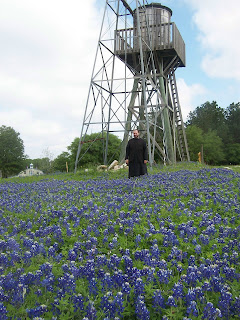 That's me in the midst of a sea of bluebonnets (the state flower of Texas) beneath the windmill that pumps water for the women's Monastery of St Paraskevi.