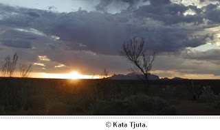 Photographer unknown: sunset in central Australia, with dramatic clouds over Kata Tjuta