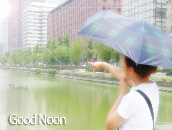 Good After noon E greetings cards and wishes with a girl standing with umbrella in noon