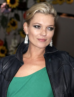 Kate Moss flaunts cleavage to promote her Topshop collection