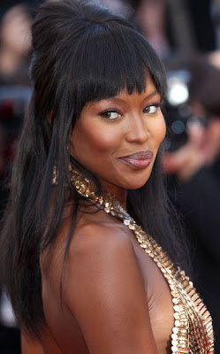 Naomi Campbell does lingerie ad for beau's luxury apartments