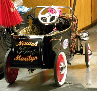 This pedal car is signed by ZZ Top guitarist Billy Gibbons, ...