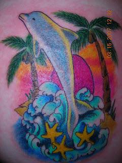 tatuagem golfinho praia
