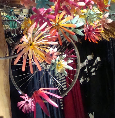 bicycle wheels and plastic bottle flowers