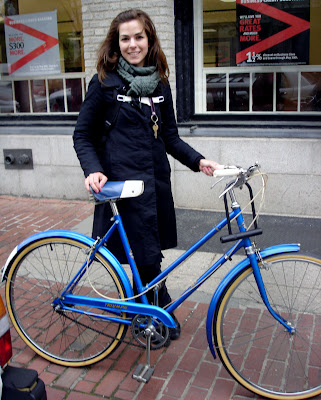 Blue Triumph bicycle with pretty girl