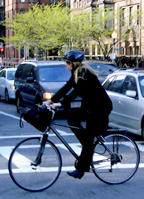 blonde in black on a bike Boston
