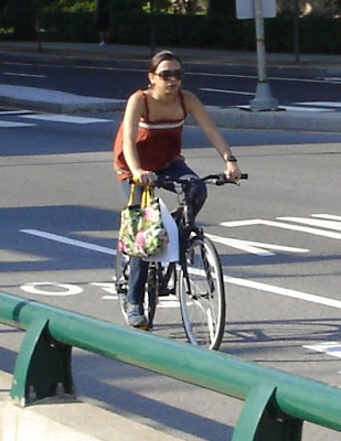 tank top and jeans on a bike