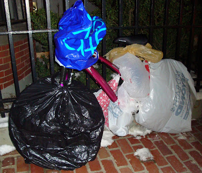 Boston bike covered in shopping bags to protect it for winter
