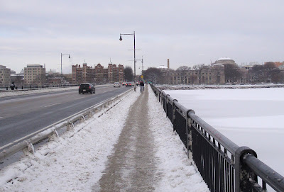 winter cyclist bridge sidewalk