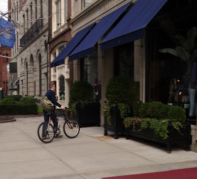 Ralph Lauren employee on a bi bike bicycle