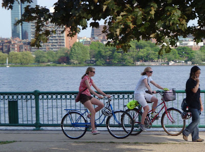 friends riding bikes in Boston