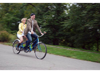 romantic couple on a tandem bicycle