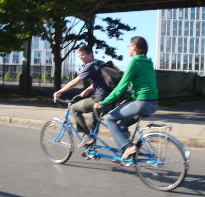 couple riding a tandem bicycle