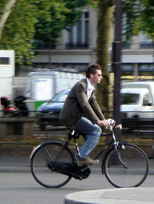 Dapper Parisian on a bike