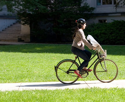 woman on three speed bike with a package