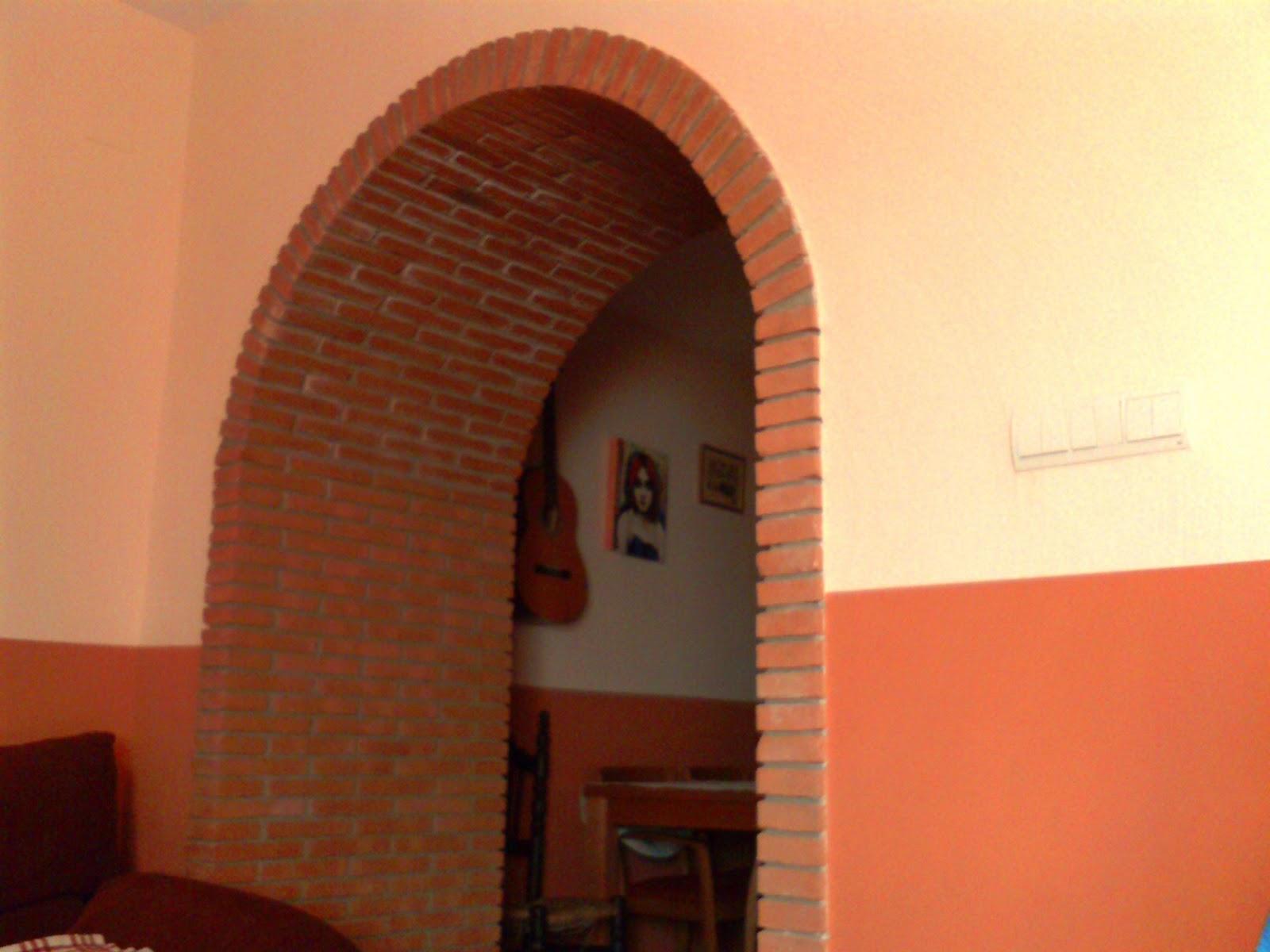 Empresa de construccion y rehabilitacion estilo rustico for Arcos de ladrillo rustico