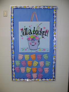 Bulletin board found outside my classroom door. My name will go above the sign. Each of my student\u0027s names is on a bucket beneath. & Babbling Abby: A Mighty Classroom