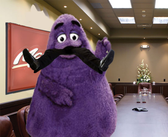 Grimace eating a McDonalds executive